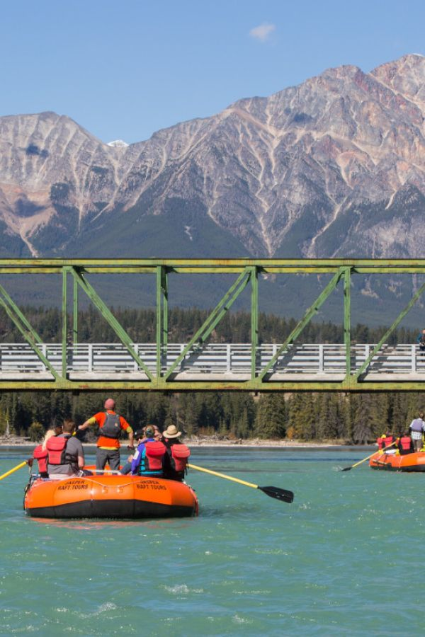 Enjoy a scenic float trip on a giant raft with Jasper Raft Tours